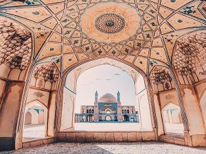 visiting Agha bozorg mosque during discover Iran tour