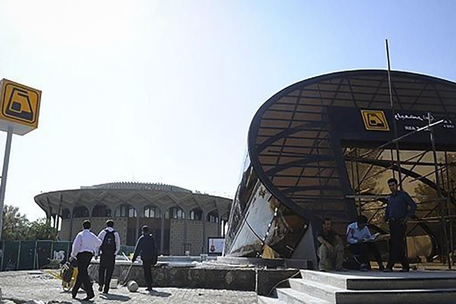 Yellow sign shows Metro station- Prices in Iran