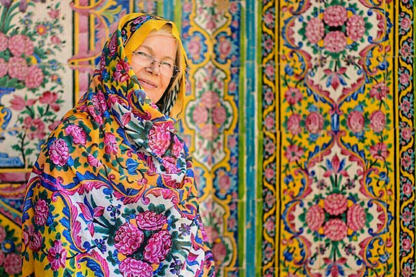 The tourist poses for photography in the Pink Mosque of Shiraz
