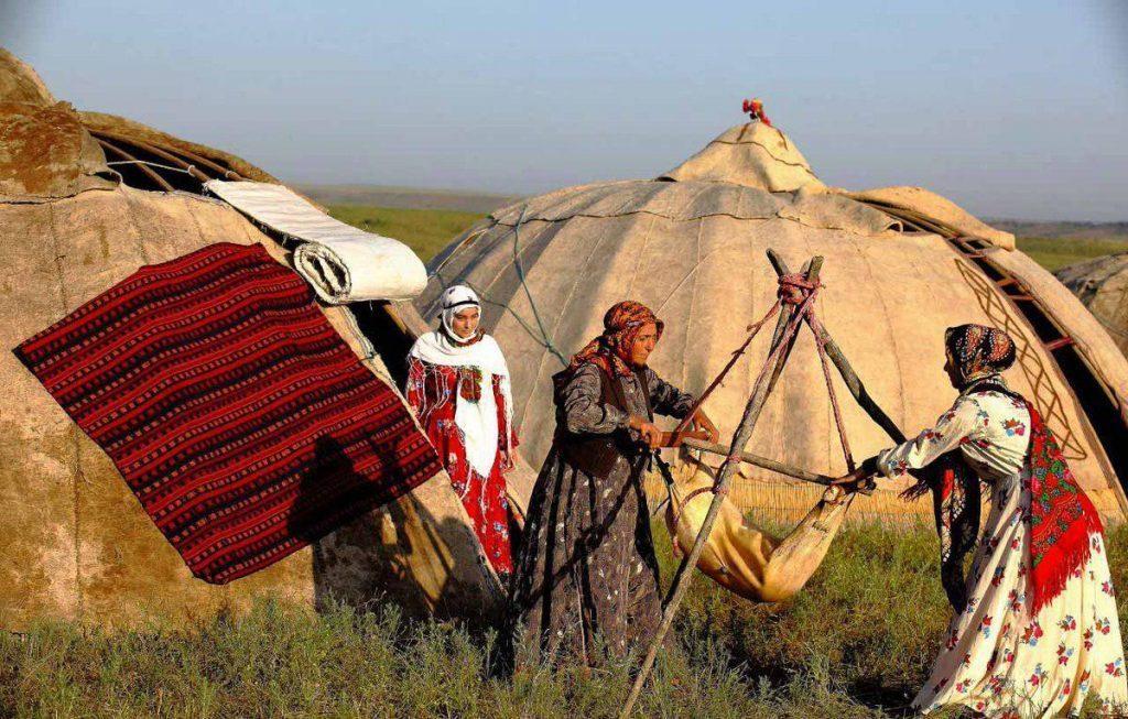 Nomad life in Iran, women making fresh yogurt